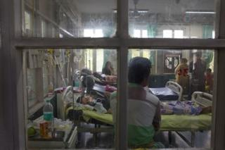 In this Thursday, Sept. 15, 2016 file photo, people suffering from fever, one of the main symptoms of several mosquito-borne diseases, recover at Ram Manohar Lohia hospital in New Delhi, India.