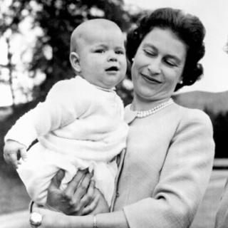 Queen Elizabeth II holding Prince Andrew during an outing in the grounds at Balmoral, Scotland