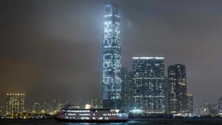 In this picture taken at night on 19 May 2016 from across Victoria Harbour, a series of a numbers is projected onto the side of the International Commerce Centre, Hong Kong's tallest building.