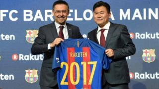 Barcelona's president Josep Maria Bartomeu (L) and CEO of Japanese company Rakuten Hiroshi Mikitani (R) display the FC Barcelona's new jersey after signing an agreement between FC Barcelona and Rakuten Inc., at Camp Nou stadium in Barcelona on November 16, 2016