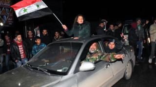 Syrians celebrate in Aleppo on 22 December 2016