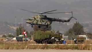 Russian Mil Mi-8AMTSh military helicopter (rotorcraft) is seen taking off at the Russian Hmeimim military base in Latakia province, in the northwest of Syria, on February 16, 2016.