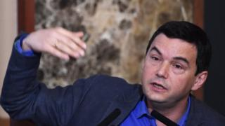 French economist Thomas Piketty answers a question during his press conference at Japan National Press Club in Tokyo on January 31 2015