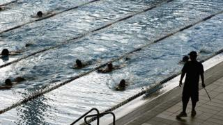 File photo: Students swim across the pool during a training session, Singapore, 2006