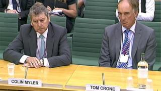 2011 photo of Colin Myler and Tom Crone giving evidence to the Commons Culture, Media and Sport Committee about phone hacking.