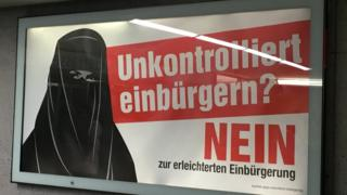 Woman in burka on poster warning against the reforms