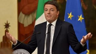 Italy's Prime Minister Matteo Renzi announces his resignation during a press conference at the Palazzo Chigi following the results of the vote for a referendum on constitutional reforms