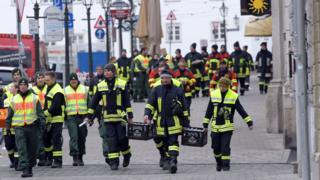 Police and paramedics on the empty streets of Augsburg
