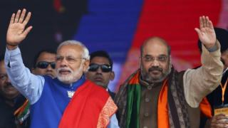 "Indian Prime Minister Narendra Modi (L) and Amit Shah, the president of India""s ruling Bharatiya Janata Party (BJP), wave to their supporters during a campaign rally ahead of state assembly elections, at Ramlila ground in New Delhi in this January 10, 2015 file photo"