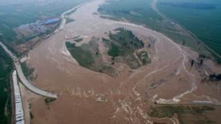 Flooded roads and fields in Hebei province, 21 July