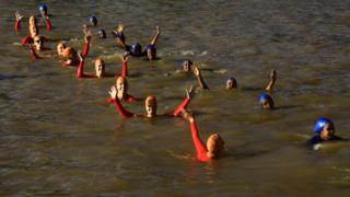Sudanese and Dutch women take part in an event to swim across the Blue Nile as part of an event organised by Dutch ambassador in Sudan in conjunction with charities that raise awareness against drowning and teach people safe swimming, Khartoum, Sudan - Saturday 26 November 2016
