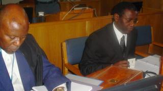 A picture taken on October 10, 2008 shows former Rwandan planning minister Augustin Ngirabatware (R) next to his lawyer Cecil John Maruma (L) during his first appearance before the International Criminal Tribunal for Rwanda (ICTR) in Arusha.