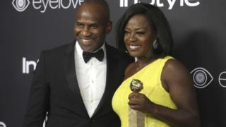 """Viola Davis, who won a Golden Globe Award for Best Supporting Actress in the film """"Fences"""" with husband Julius Tennon."""