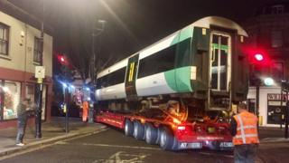 A lorry carrying a carriage from a Southern Rail train gets stuck after trying to negotiate a tight bend in Crystal Palace