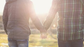 Gay men holding hands