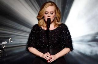 Adele on stage, 2015