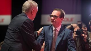 Owen Smith congratulates Jeremy Corbyn after a choosing outcome was announced