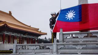 Guards prepare to raise the Taiwan flag in the Chiang Kai-shek Memorial Hall square ahead of the Taiwanese presidential election in Taipei, Taiwan, 14 January 2016