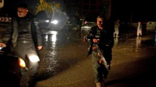 Afghan security personnel check a vehicle along a street after an unknown number of assailants mounted the attack from a building close to the Indian consulate in Mazar-i-Sharif, prompting Afghan forces to cordon off the area, late on January 3, 2016.