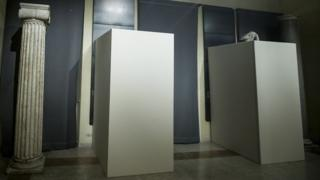 Plywood boxes conceal nude statues at a museum in Rome for the Iranian president's visit