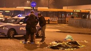 Italian Police officers work next to the body of Anis Amri, the suspect in the Berlin Christmas market truck attack, in a suburb of the northern Italian city of Milan, Italy December 23, 2016