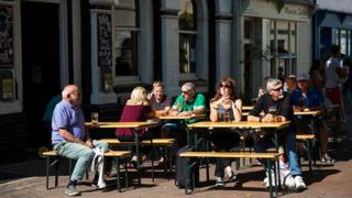People sitting outside a pub