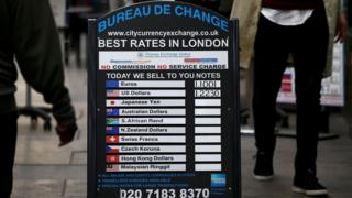 """A bureau de change advertises its"""" rates on board in London, Britain October 7, 2016"""