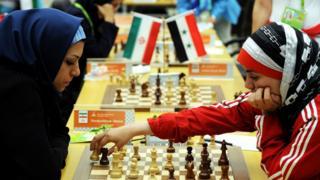 Fatemah al-Jeldah (R) of Syria makes a move against Atous Pourkashiyan of Iran, China 2010