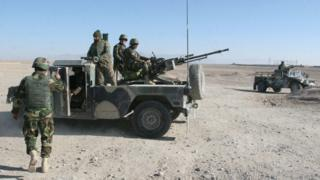 In this Wednesday, Dec. 23, 2015 file photo, Afghan National Army soldiers guard a checkpoint on the way to the Sangin district of Helmand province, Afghanistan. After months of ferocious fighting,
