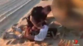 An Australian man, 59, is arrested on a remote beach south of Adelaide over the attempted murder and kidnapping of two backpackers