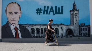 "A mural of Russia's Vladimir Putin in Simferopol (file pic 2015) with the slogan ""Ours"""