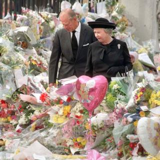 The Queen and the Duke of Edinburgh viewing the floral tributes to Diana, Princess of Wales, at Buckingham Palace