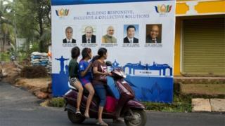 Locals in Goa glance during a print for a Brics meeting