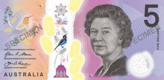One side of the new five dollar note showing Queen Elizabeth