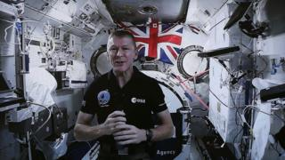 """Tim Peake launching the """"cosmic classroom"""" in which he can talk to children via a live link"""
