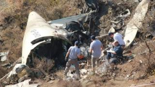 Overseas investigators examine the wreckage of a Pakistan International Airlines (PIA) passenger plane which crashed near the village of Saddha Batolni in the Abbottabad district of Khyber Pakhtunkhwa province on December 13, 2016