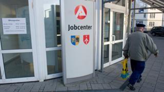 A man walks past an unemployment office