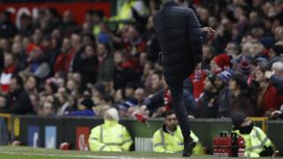 Jose kicking a water bottle