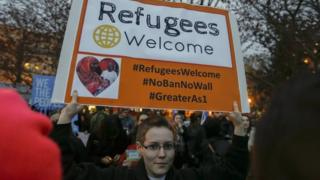 Protesters outside the White House after President Donald Trump signed an executive order on a revised travel ban.