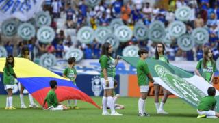 Colombian and Chapecoense flags held on the pitch before Cruzeiro v Corinthians match in Belo Horizonte