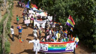 Members of the lesbian, gay, bisexual and transgender community parade in Entebbe, southwest of Uganda's capital Kampala on 8 August, 2015.