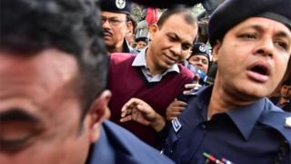 Bangladeshi Commander in the Rapid Action Battalion (RAB) Tarek Sayeed (centre) is escorted by police at Narayanganj court in Narayanganj on January 16, 2017.