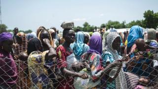 Women and children queue to enter a Unicef nutrition clinic in Borno state - September 2016