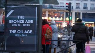 "A poster reading ""The Bronze age - 3200 BC to 600 BC; The Oil age - 1859-2015"""