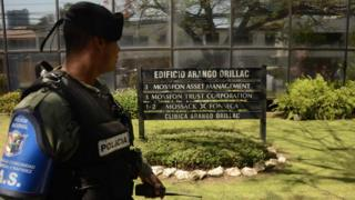 A policeman stands guard outside Mossack Fonseca headquarters in Panama, April 13, 2016