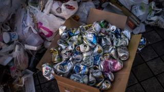 A box of empty beer cans is seen in a rubbish pile after ' Hanami' or Flower-viewing parties in Ueno Park, on March 30, 2015 in Tokyo, Japan.
