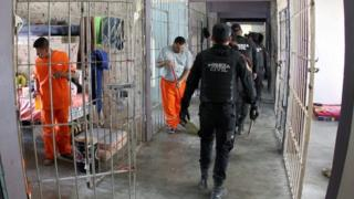 A handout picture provided by the Government of Monterrey shows police officers conducting a search in the Topo Chico Prison in Monterrey, Mexico on 14 February 2016