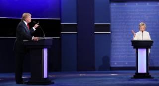 Democratic presidential nominee Hillary Clinton debates with Republican presidential nominee Donald Trump during the third US presidential debate on 19 October 2016.