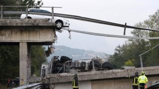 A car suspended at the collapsed bridge between Milan and Lecco, northern Italy, 28 October 2016.