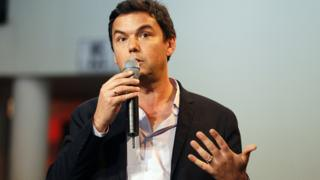 Thomas Piketty with microphone